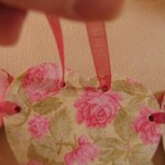 put-ribbon-through-holes-as-shown-and-tie-a-bow