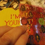 stencil-words-on-wooden-hearts