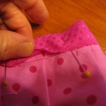 pin-ribbon-to-edge-of-fabric-as-shown