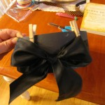 apply black ribbon and tie bow