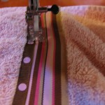 stitch along edge of ribbon