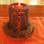laced up candle cover