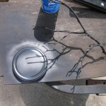 spray paint lid and branch