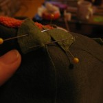 Hand sew leaves and stem on as shown