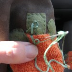 tack down embroidery floss as shown