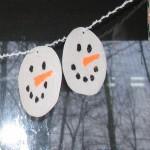 punch hole in each snowman