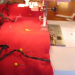 stitch along edges using a half inch seam allowance leaving the end open where your battery pack will come out.