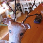 oke two holes in the top of the head and then poke twigs in the holes for antlers