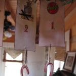 I hang a candy cane on the bottom to mark each day until Christmas