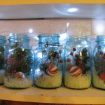 mason jars 2 150x150 Mason jars filled with Christmas picks,snow, and lights for holiday cheer!