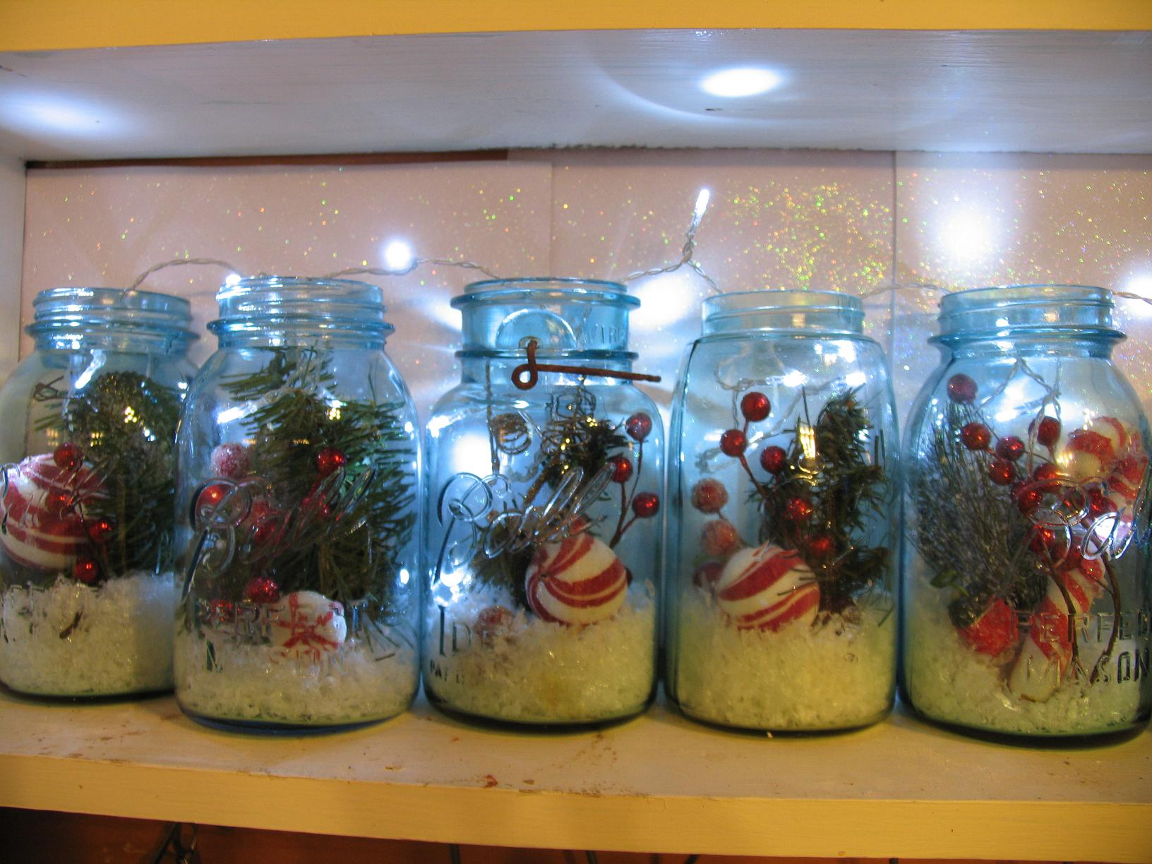 Mason jars filled with Christmas picks,snow, and lights for ...