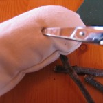 punch four holes in the underside of the body using an icepick or sharp pointed scissors