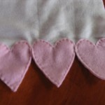 heart border at ends of scarf