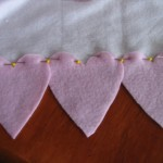 pin three hearts to each edge of scarf.