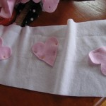 pin hearts on scarf as shown