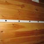 attach rail to wall using screws or nails