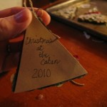 cut a piece of paper to put on back to cover ribbon ends and write on it 150x150 Christmas tree ornaments made with wood pieces
