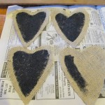 cut heart shapes from burlap and paint with chalkboard paint
