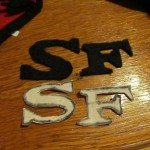 cut out an s and an f from black felt for each piece
