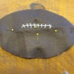 pin two footballs together leaving an opening in the bottom to stuff