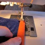 turn over a half inch to back and stitch as shown