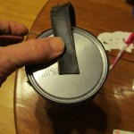 use hot glue to attach the strap to bottom of can