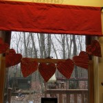 heart garland hanging on window