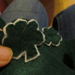 stitch the shamrock to shoe as shown